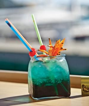 Tortuga Gorda Cocktail This fruity tropical island drink packs quite a punch with 4 types of liquor. 1 oz. Cruzan 151 rum  1 oz. pineapple rum 1 oz. blue Curaçao 1 oz. melon liqueur 1 oz. each of pineapple juice     and orange juice 1 oz. Sprite 1. Mix in a big glass with ice. Stir, then garnish with an orange and a cherry.