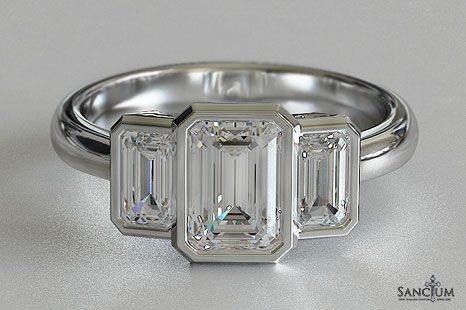 Bezel set emerald cut engagement ring