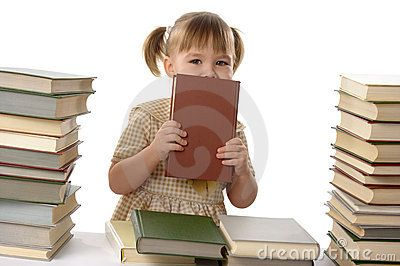 Little girl hiding behind the book, back to school
