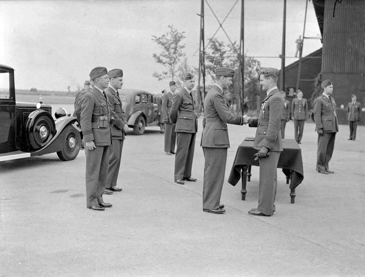 SEP  24 1940 George Cross created, Londoners remain 'determined' - See more at: http://ww2today.com  King George VI congratulates Flight-Lieutenant A C Deere, on decorating him with the Distinguished Flying Cross at Hornchurch, Essex. To the King's left stands Air Chief Marshal Sir Hugh Dowding, Air Officer Commander-in-Chief, Fighter Command.