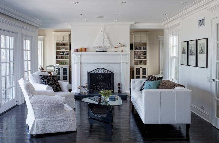 crisp nautical living room with dark wood floors and white