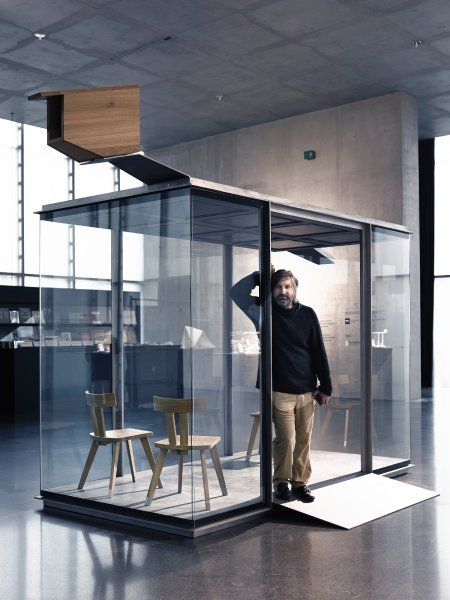 Chilean architect Smiljan Radic standing in his completed bus shelter. Image © Adolf Bereuter / BUS:STOP Krumbach