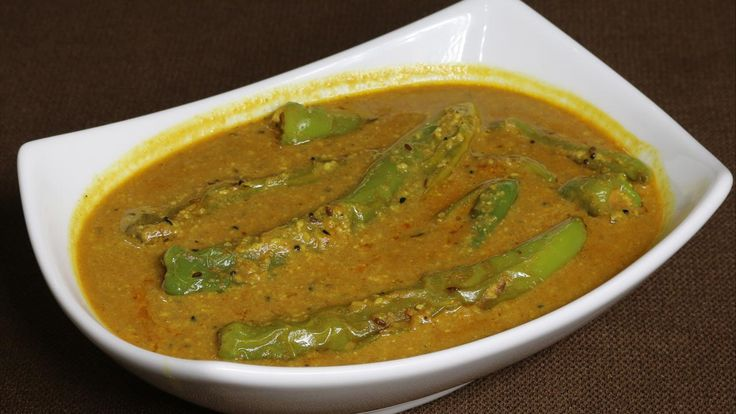 """""""Mirchi ka Salan"""" is a popular Hyderabadi dish. Generally speaking, Hyderabadi dishes are very spicy and aromatic, and this is one of them. Even the name of this dish """"Mirchi ka salon"""" reflects that. Mirch is pepper and Salan means curry. The chili pepper is cooked in a peanut and coconut spicy curry."""