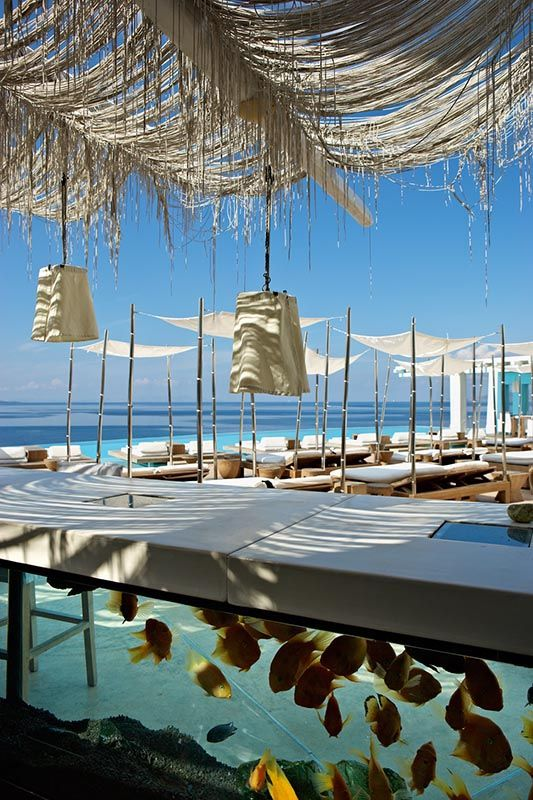 The Aquarium Bar by the infinity pool at the Cavo Tagoo Hotel in #Mykonos, Greece http://www.mediteranique.com/hotels-greece/mykonos/cavo-tagoo/