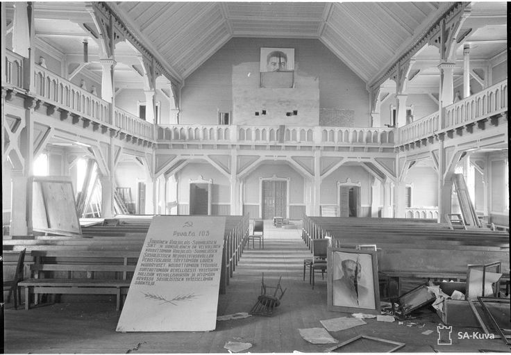Kurkijoki church, 12 August 1941. The city was taken by the Soviets in the Winter War and occupied for shortly over a year. During that time, the Soviets turned the church into a cultural centre. The communist propaganda has been desecrated, likely by the liberating Finnish troops. The town would fall to the Soviet Union again in the Red Army's summer 1944 Karelian Offensive.