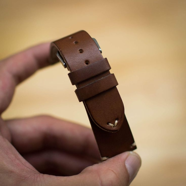 A personal favorite from my Etsy shop https://www.etsy.com/listing/502460819/handcrafted-leather-watch-strap-22mm