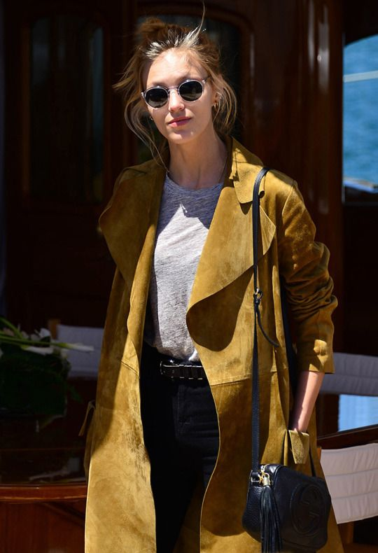 great suede coat and round frame sunglasses