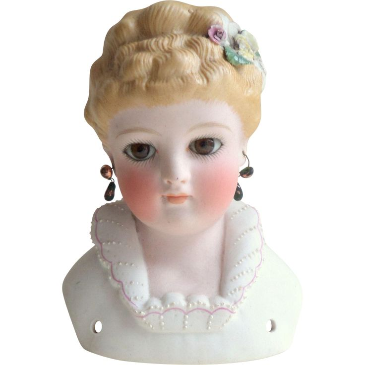 Kling Parian Doll Head c. 1890 with glass eyes that haunt you with their loveliness.  Great floral detail and collar.  Note the delicate earrings; she could have stepped out of a Godey's or Petersen's Magazine.