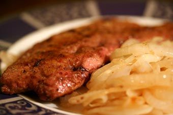 Liver and Onions ~ Liver and onions recipe, calves liver, dredged in seasoned flour, sauteed in bacon fat, with thinly sliced onions.  ~ SimplyRecipes.com