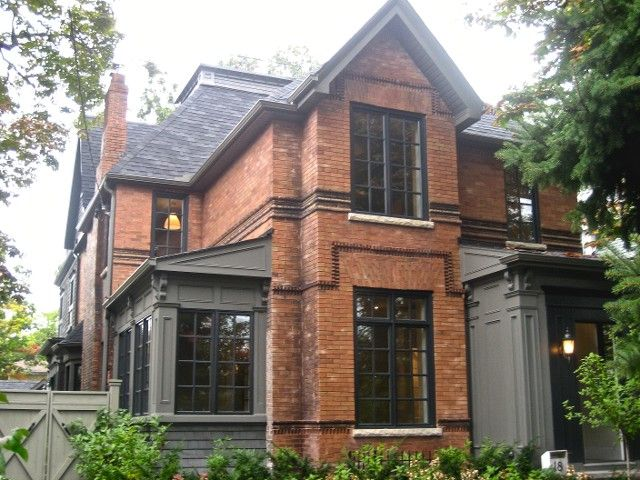 Historic red brick home with grey addition toronto house addition ideas for Exterior window trim for brick home