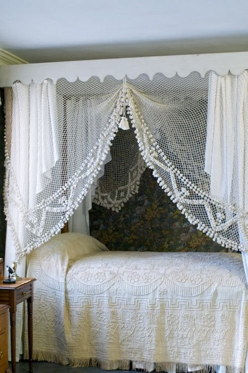 Now this is awesome...love the vintage nook and bedding...sheer and lace...love this