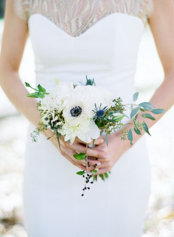 A sweet and simple bouquet of anemones, thistles, peonies, astilbe, and seeded eucalyptus