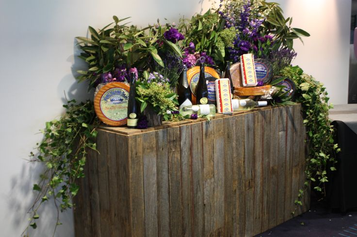 Decor It Events rustic food station featuring cheese, wine and seasonal flowers and foilage #food station #juice bar #foodstyling #flowers #purple flowers