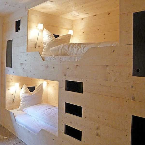 plywood storage nook contains two beds/sleeping spaces