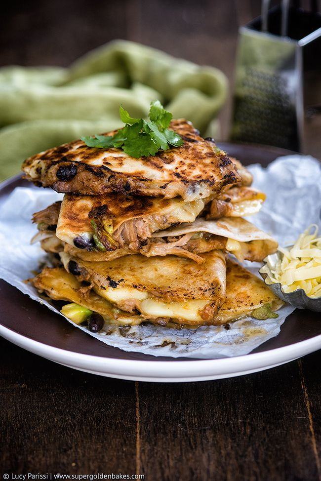 Totally delicious cheesy quesadillas with juicy slow-cooker pulled pork, black beans and avocado.