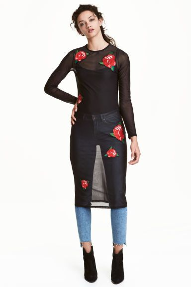 Embroidered mesh dress: Long-sleeved, knee-length mesh dress with embroidered appliqués on the front.