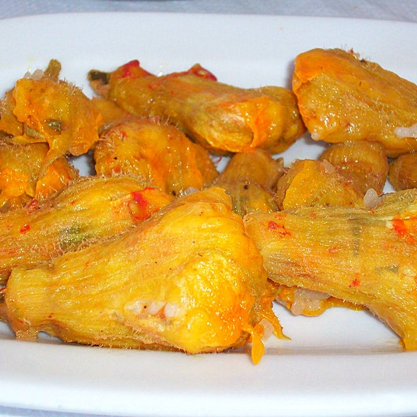 Anthous ~ Courgette flowers ~ These are delectable and totally irresistible!!!  Stuffed with a mixture of rice, grated aubergines, courgettes, onions, tomatoes, olive oil and chopped parsley and mint. One of the most popular foods in Crete.....  :))