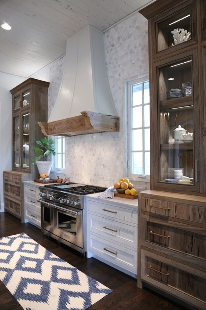 BECKI OWENS- The Kitchens of Old Seagrove Homes today on the blog! Check out these pretty white kitchens with fresh coastal style, mosaic tile, natural cypress wood, and beautiful brass lighting.