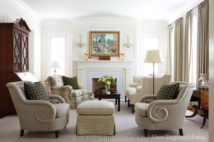 "A hint of blue on the ceiling quietly enhances the living room's airiness, as do the upholstery's neutral tones. ""Nothing is overdone in this house,"" says designer Amy Aidinis Hirsch. The painting, Parisian Boulevard, is by Constantine Kluge."