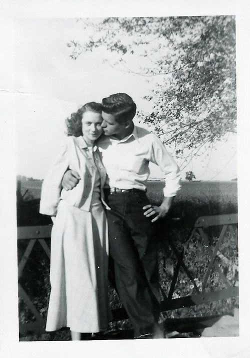 1940s found photo snapshot couple woman man young fence country tree romantic War Era WWII vintage fashion style shirt pants dress sweater jacket hairstyle