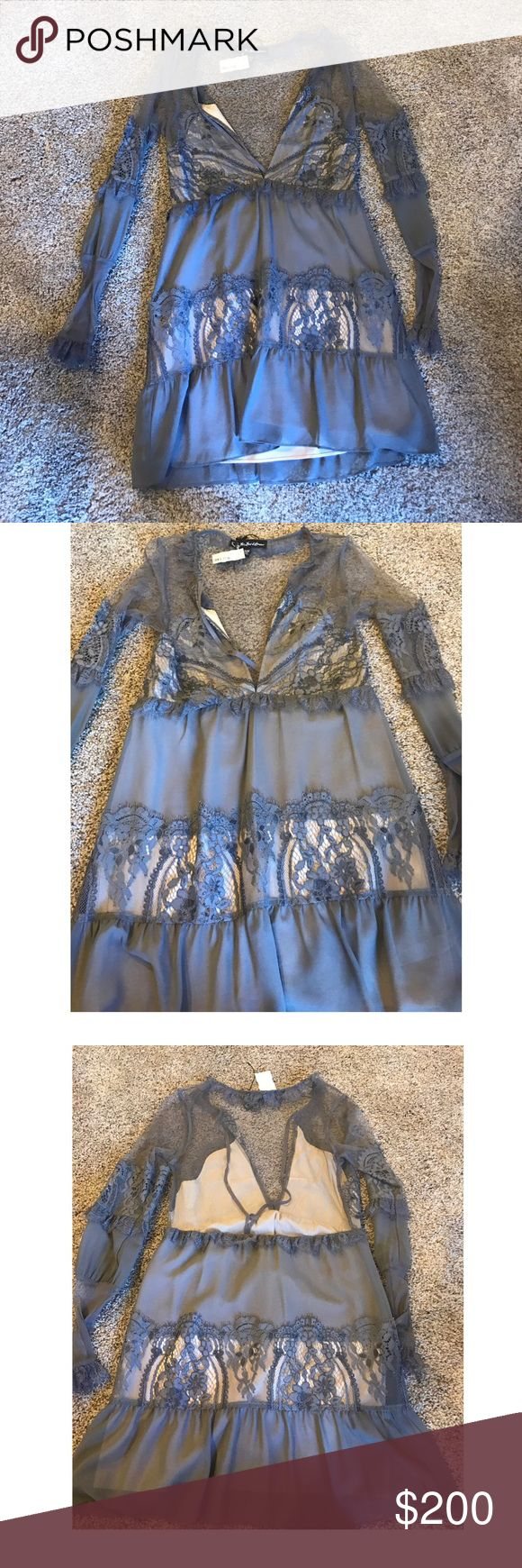 For Love and Lemons grey long sleeve dress New never worn with tags For Love and Lemons long sleeve sheer with lace grey baby doll style dress. Has a lining. Great for any occasion For Love and Lemons Dresses Mini