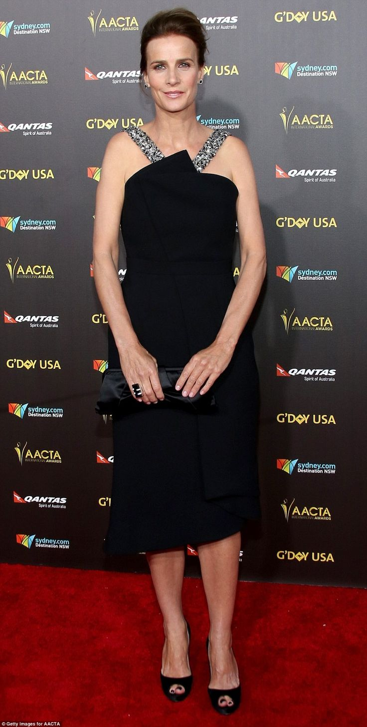 Hollywood glam: Actress Rachel Griffiths made a fashion statement in a sexy black dress wi...