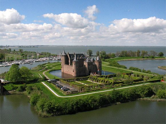 The Muiderslot is a castle in the Netherlands, located at the mouth of the river Vecht, some 15 km (9.3 mi) southeast of Amsterdam, in Muiden, where it flows into what used to be the Zuiderzee (drained bay).
