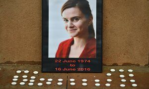 Candles surround a photo of Labour MP Jo Cox in George Square, Glasgow.