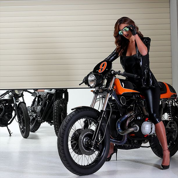 Cafè racer bike with model Bárbara Amérigo for Officine Locati's new rolling shutter; the bike is custom made by Fratelli Brambilla Monza.