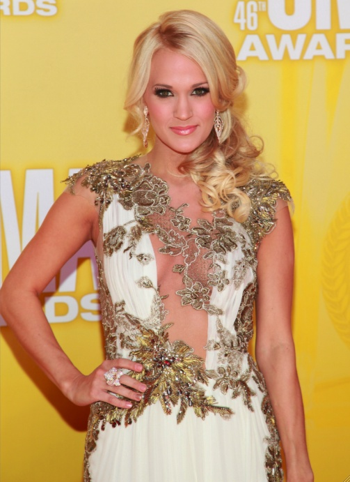 Of all Carrie Underwood's CMA wardrobe changes, this sheer applique gown was the most striking. Love it or hate it?