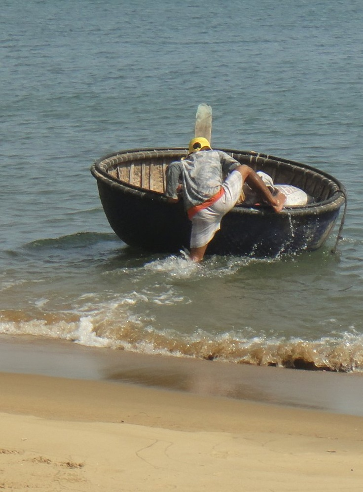 A basket boat, more properly known as a 'coracle'. These are woven, then coated with tar to waterproof them. Surprisingly little water resistance. Great design. They bob around merrily atop the waves, all over Danang's coastline