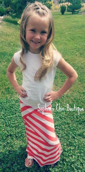 Love the little maxi skirt & cute hair.