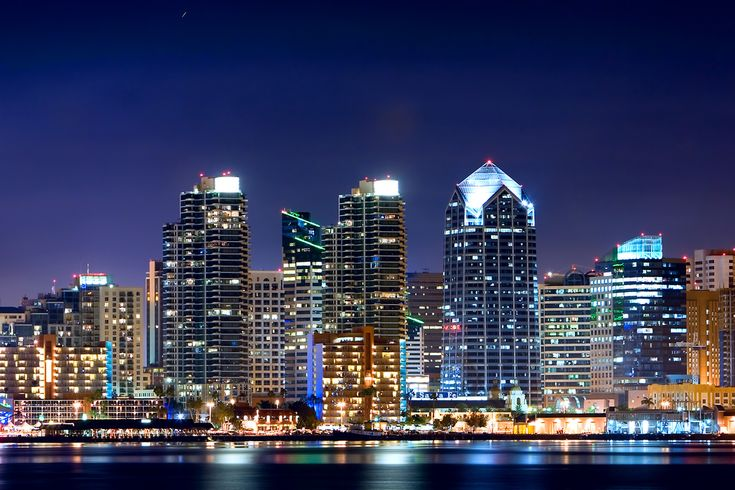 The bright city lights of Downtown San Diego at night, as viewed from Harbor Island