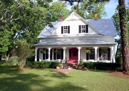 Victorian Southern Country Home. Black or plain wood door.