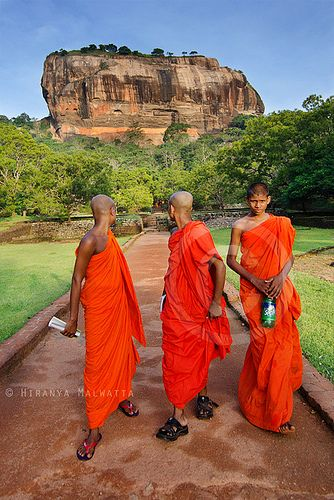 Two look back, Sigiriya. A rock fortress, former 5th C. palace, later a buddhist monastery. Sri Lanka.