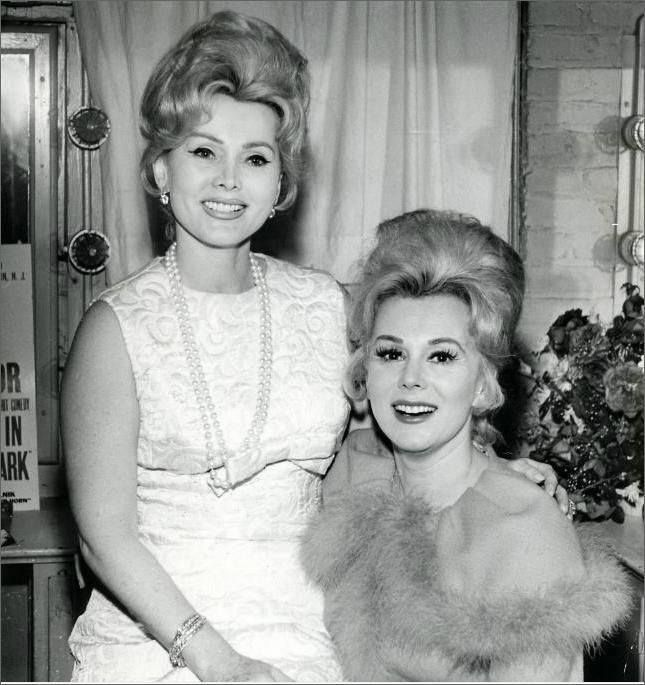 Two very sexy sisters. Zsa Zsa to the left and Eva Gabor on the right.