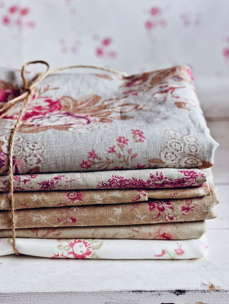 A pile of antique linens at Cabbages and Roses...Full review with images galore on Modern Country Style blog: Living Life Beautifully by Christina Strutt: Book Review