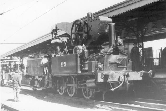 "No. 3 Steam Crane, ""Polly"". Because of this locomotive it was possible to see a remnant of steam in Melbourne long after the North Melbourne Locomotive depot closed down in 1965. I saw it steaming through Flinders Street station in 1975. By the time this picture was taken, in 1968, a decision had been made to restore it back to its original status as locomotive Z526. This eventually happened when it was preserved in 1980."