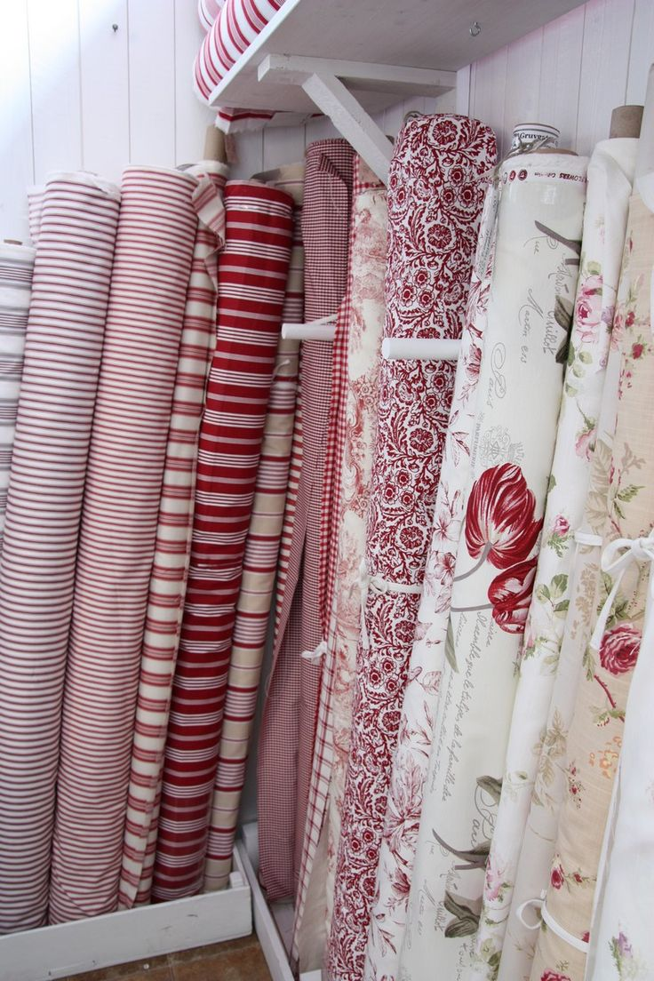 Rolls of Cranberry & White Fabric ....