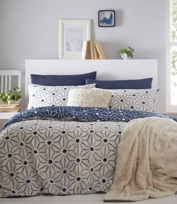 Great for introducing contemporary prints to any bedroom, this set from The Collection will make a stylish addition to a home interior. Featuring an all-over geometric pattern in a white finish, it has a reversible side in a dark navy hue - ideal for versatile styling.