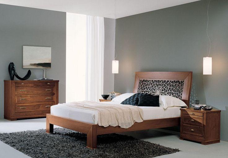 arredamento camera da letto contemporaneo con mobili in legno e pareti grigie