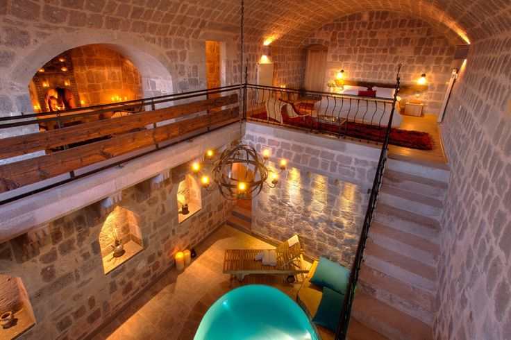 Carved into the otherworldly rock formations of this part of Turkey, the Splendin Suite at Argos in Cappadocia is a sumptuous cave retreat with natural stone walls and a traditionally inspired bedroom area elevated above the private indoor swimming pool.