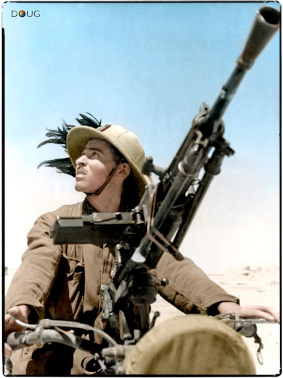 This a possible identification of an Italian Bersaglieri Motorised Marksman of the 10. e 10.bis compagnie moto (motorcycle companie). He is on a motorcycle armed with a 6.5mm Breda 30 machine gun. Near Sidi Omar in the Butnan District of Libya during the Western Desert Campaign. November 1940. By DOUG