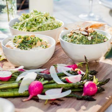Spring platter of bread, dips and roasted asparagus and radishes