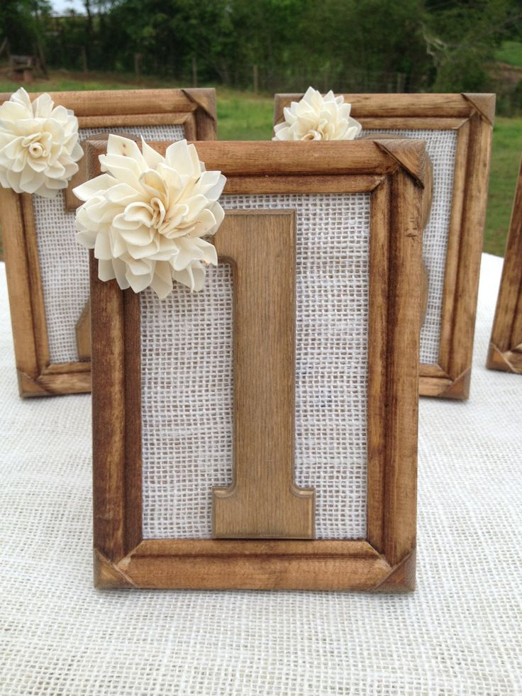 "These frames measure 4x6 & 5x7 and the wooden numbers inside are 5"" tall. These wooden frames are hand stained and then sealed to prevent fading or rusting. Numbers are attached to an ivory burlap pie"