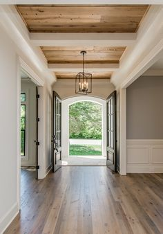 Beautiful home interior. Love those hardwood floors and beams on the ceiling.