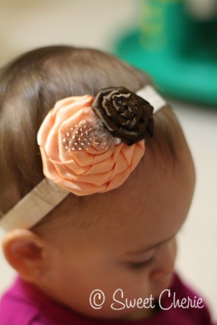 Baby Headband - Satin Peach and Brown Rosettes with Spotted Feather and Pearl setting   - baby hairbow, baby girl headband. $14.75, via Etsy.