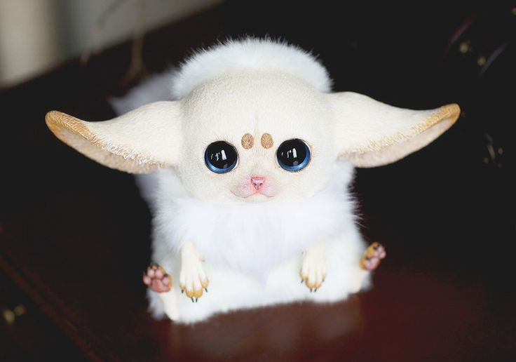 Inari Foxes: Nude by Santani http://www.boredpanda.com/creepy-cute-fantasy-dolls-santani/ life like fantasy toy animals