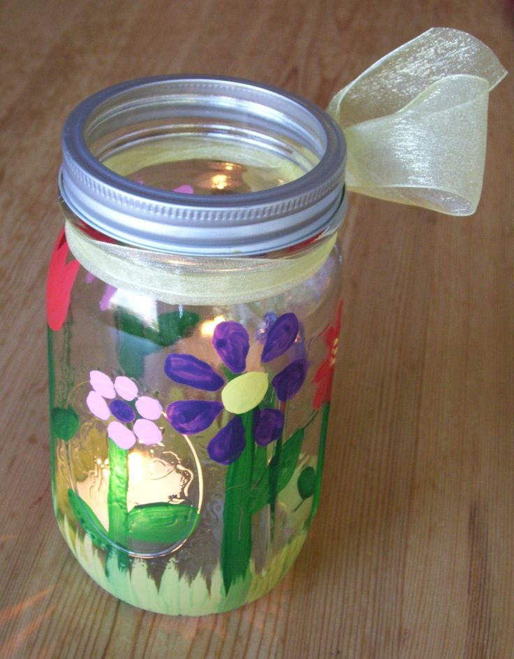 Mother's Day project - Painted a mason jar with acrylic paints.  Could be a candle/tea-light holder or a flower vase. Multiple day project (for Grade ones: paint stems first day, add flowers next day, finish with the grass.