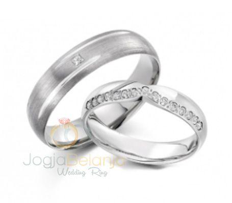 Meski memiliki desain berbeda, cincin pasangan ini tetap tampil romatis dan elegan. Cincin Pernikahan Radhika hadir dengan bahan logam solid palladium 50% yang menyerupai emas putih. Cincin pasangan wanita menonjolkan tatanan batu zircon putih yang cantik, sedangkan cincin pasangan pria tampil elegan dengan desain minimalis. Anda tertarik dengan cincin pasangan ini? Hubungi kami untuk melengkapi...  Read more »
